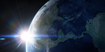 Sunrise in space with prominent sun flare and sun streaks. North America, Caribbean and South America region. Elements of this image furnished by NASA. 3d illustration