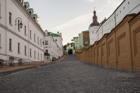Old road of Pechersk Lavra Monastery in Kiev, Ukraine. Shot on a summer evening with no people in the shot. Stock Photo