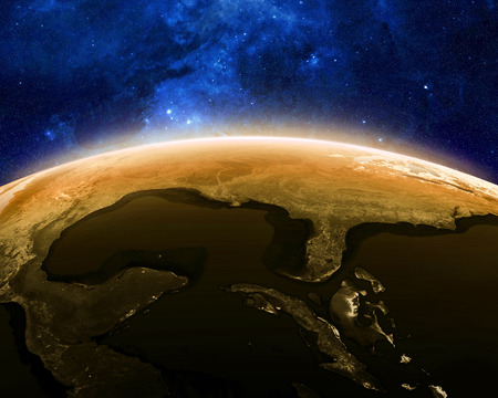 Earth at night as seen from space with blue, glowing atmosphere and space at the top. Perfect for illustrations. Stock Photo