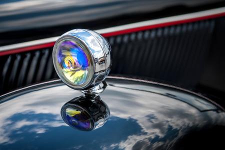 Closeup shot of a head lamps of a black retro car