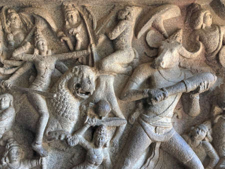 Bas relief rock cut sculptures of gods, people and animals are carved prominently in the monolithic cave temples at Mahabalipuram, Tamil nadu, India Reklamní fotografie
