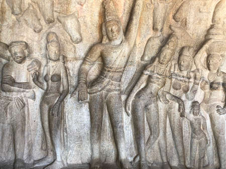 Bas relief rock cut sculptures of gods, people and animals are carved prominently in the monolithic cave temples at Mahabalipuram, Tamil nadu, India