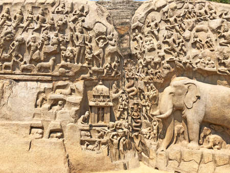 Descent of the ganges: A giant open air rock cut bas relief sculptures carved on two monolithic rocks in Mahabalipuram, Tamil nadu. It contains sculptures of animals, God, People and half-humans. Reklamní fotografie