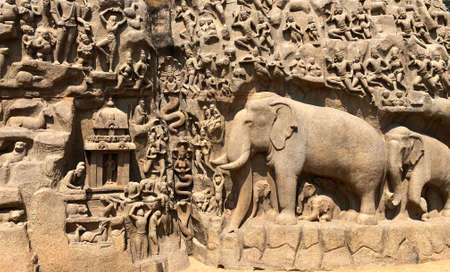 Descent of the ganges: A giant open air rock cut bas relief sculptures carved on two monolithic rocks in Mahabalipuram, Tamil nadu. It contains sculptures of animals, God, People and half-humans.