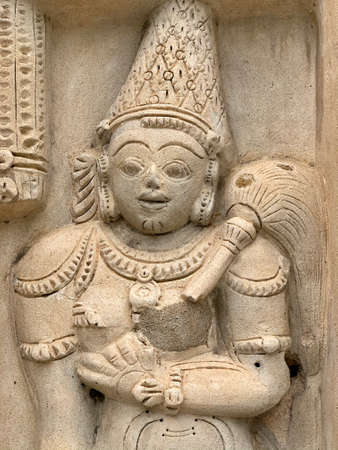 Ancient sandstone carved historical Hindu God sculptures in the temple walls. Carved idols in ancient Kanchi Kailasanathar temple in Kanchipuram, Tamilnadu.