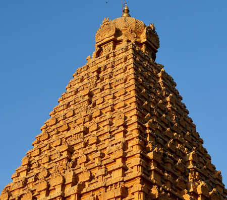 Brihadeeswarar temple in Thanjavur, Tamilnadu, India. Lord Shiva temple exterior tower against blue sky background. Ancient historical temple tower with Hindu God sculptures in Tamil nadu. Stock Photo