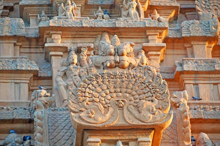 Bas relief ancient sculptures carved on the walls of historical Brihadeeswarar temple in Thanjavur, Tamilnadu. Indian rock art relief carvings of ancient God sculptures in temple walls in Tamilnadu.