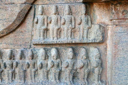 Bas relief ancient sculptures carved on the walls of historical Brihadeeswarar temple in Thanjavur, Tamilnadu. Indian rock art relief carvings of ancient God sculptures in temple walls in Tamilnadu. Stock Photo