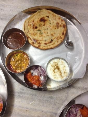 punjabi: Its a traditional punjabi thali with Dal Roti Sabji Raita and onions as salad. Stock Photo