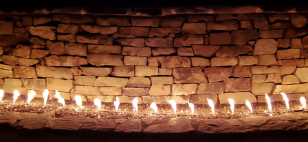 This is the beautiful fireplace at the patio out side the house . The peaceful night and warm in winter time. A fireplace is structure made of brick. The fireplaces are used for the relaxing ambiance they create for heating.