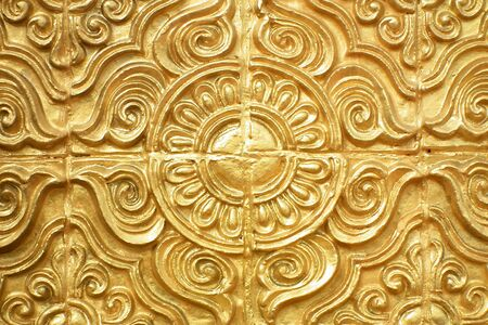 Gold-colored stucco,Temple in Thailand Stock Photo