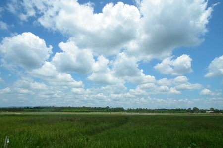 Mass of clouds over the prairie wide.