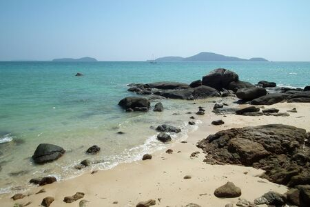 Beach with waves and rocks,Phuket Thailand Stock Photo