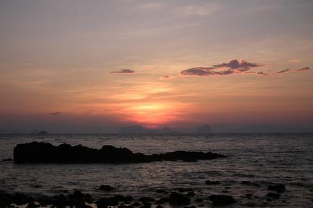The morning sun rises over the sea,Lanta Krai Thailand Stock Photo