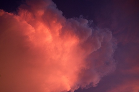 Purple clouds in the evening. Stock Photo