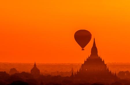 Beautiful sunrise view of Bagan Pagodas and hot air balloons in the sky, Bagan, Myanmar