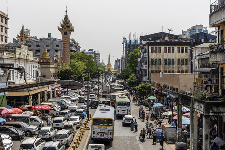 Yangon Myanmar 2016: Busy downtown street view in Yangon and Sule Pagoda at the heart of Yangon city, Myanmar Editorial