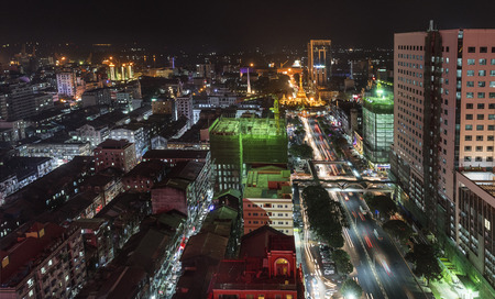 Lighted Sule Pagoda and its surrounding apartments at night, Yangon, Myanmar