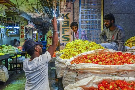 People selling Fresh flowers in wholesale inside KR flower market India which is one of the biggest flower markets in Asia