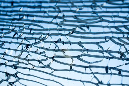 tempered: Tempered glass cracked closeup, background with copy space