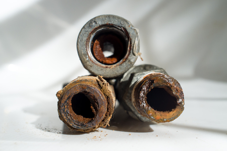 Embolism: A pipe clogged with sediment rust