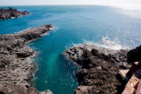 asia,beach,beautiful,blue,cliff,coast,coastline,columnar,daepo,explore,explorers,island,jeju,joint,jungmun,jusangjeolli,korea,natural