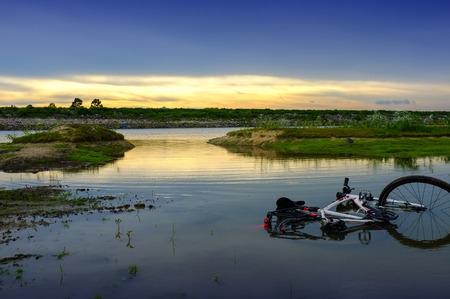 Plenty lakeside, Moisture pond at sunset with bicycle Stock Photo