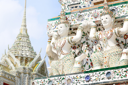 Angel at The temple of the dawn or Wat Arun Ratchawararam: Wat Arun renovation done properly.