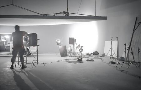 Interior of a photography studio with professional equipment. Copyspace in the photo.