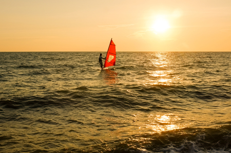 Windsurfing with sunset at Jomtien beach, Pattaya, Chonburi,  Thailand