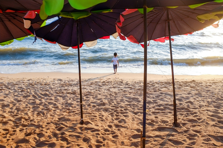 Beach umbrella with sunset at Jomtien beach, Pattaya, Chonburi, Thailand.