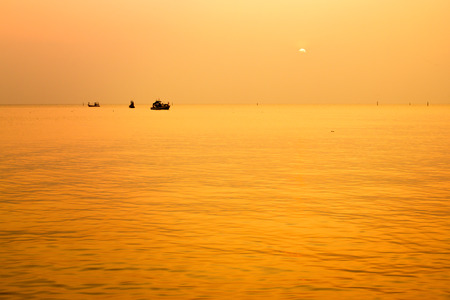 The sunset with fishing boat in the Gulf of Thailand, Bang Saen, Chonburi, Thailand.