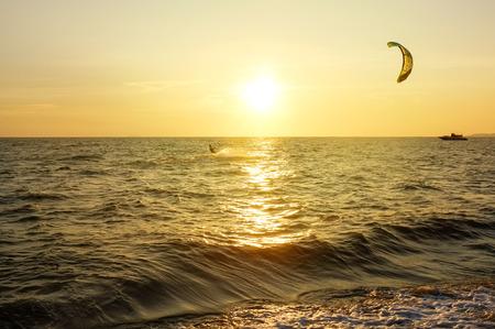 Kite-surfing with sunset at Jomtien beach, pattaya, Chonburi, Thailand