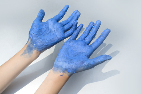 Blue painted on a girl's hands