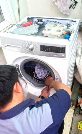 Replace or repair: Can not open the washing machines door. It need to use lubricant or needs to replace.