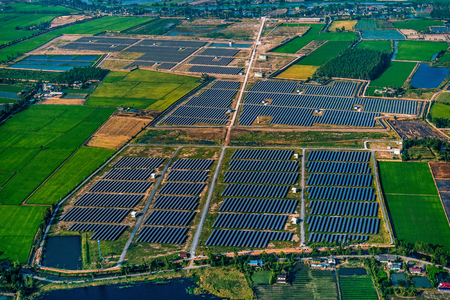 human energy: Aerial Solar Farm in Nakorn Phatom, Thailand Stock Photo