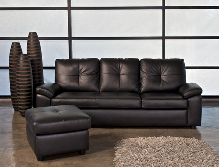 stool: Bllack leather sofa with stool