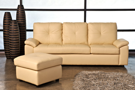 stool: Beige leather sofa with stool