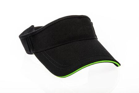 peak hat: Mens black golf visors on white background Stock Photo