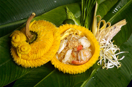 creole: Thai noodles with the seafood serve in bowl carved from pumpkin Stock Photo
