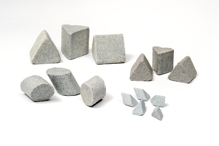 Industrial  sharpening stones sets in different shapes on white background