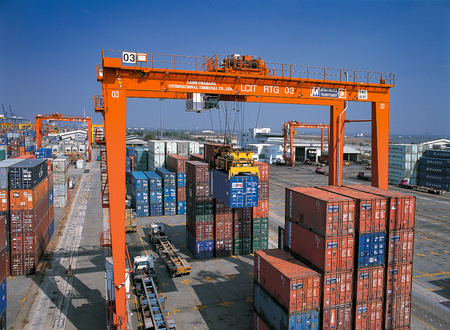 Moving Containers in Ports Shipyard and loading into the ship in Thailand