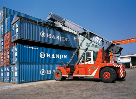 Moving Containers in Ports Shipyard and loading into the ship