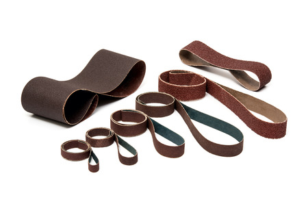 Industrial Sanding Belts Sand Papers in Rolls on White Background