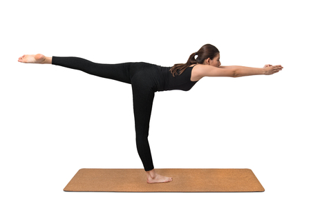 Yoga pose, young woman exercise on cork yoga mat on white background