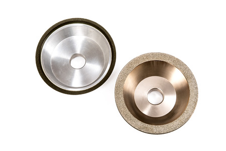 Industrial grinding and polishing wheels on white background Stock Photo