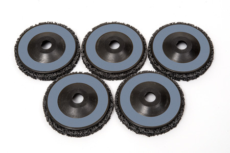 Grinding and polishing wheels on white background