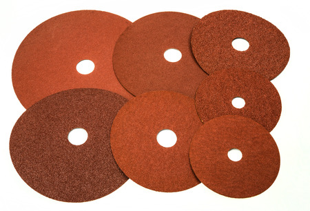 Sandpaper for industrial and home use in different sizes and thickness on white background Stock Photo