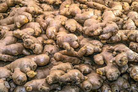 Full basket of ginger is on display for sale in the fresh vegetable market Stock Photo