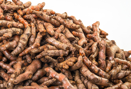 Fresh turmeric roots display on sale in the fresh vegetable market